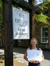 Felicity and Trip Advisor Certificates of Excellence for Old Convent Holiday Apartments near Loch Ness Scotland